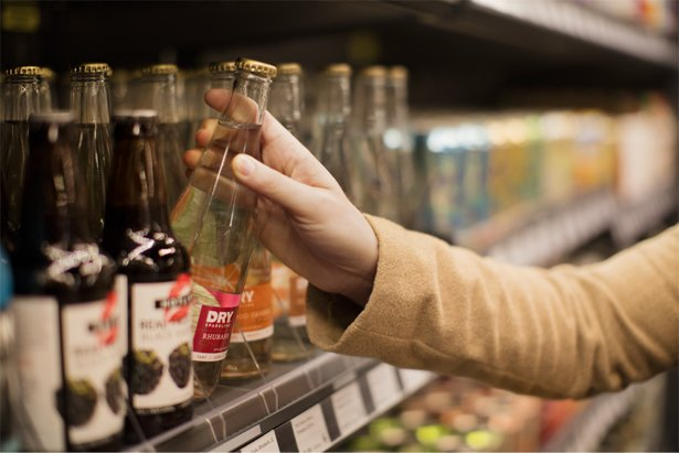 grabbing-bottle-from-shelf