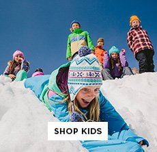 cp-3-kids-2016-10-17 Shop Burton Kids. Image of a little girl sledding down a hill