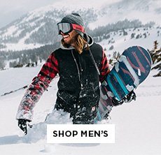 cp-1-men-2016-10-17 Shop Burton Men. Image of a man in snow holding a snowboard