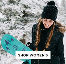 cp-2-women-2016-10-17 Shop Burton Women. Image of a woman in snow holding a snowboard