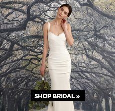 cp-1-nicole-miller-2017-1-13 Shop Bridal. Image of a woman in a white bridal gown from the back.