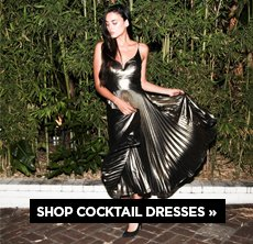 cp-2-nicole-miller-2017-1-13 Shop Cocktail. Image of a woman in a black cocktail dress