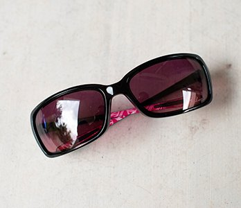 Black Frame Sunglasses With Polarized Lenses And Pink Inside