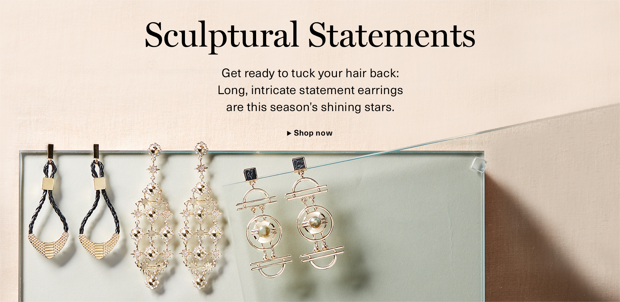 Sculptural Statements: Long intricate earrings are this season's shining stars.