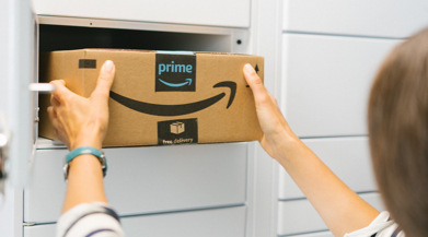 Photo of woman reaching in and pulling out her amazon package from gray locker.