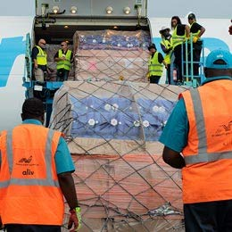 Airport workers prepare to unload a cargo plane.