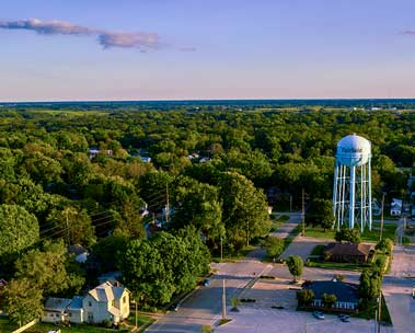 Aerial view of a small town and a water tower.