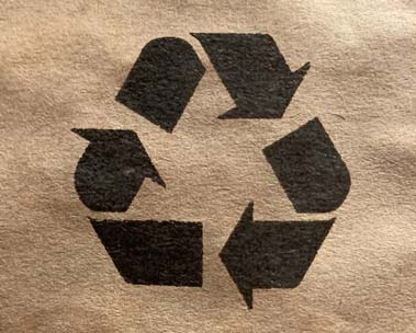Detail of a padded envelope with a recycling logo on it.