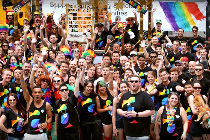Employees celebrate at a LGBTQ event