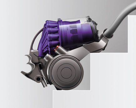 The Dyson DC23 sits on stairs