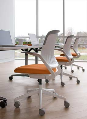 Image of orange cobi office chairs at conference table