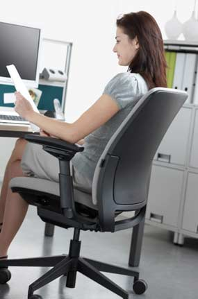Image of office worker in chair