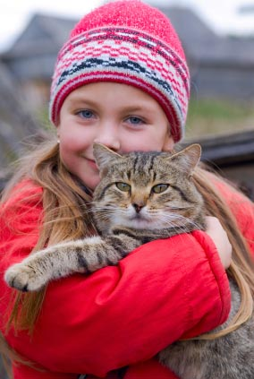 Picture of girl holding healthy cat