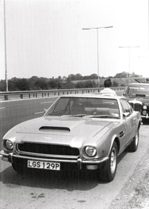 Bushkin's Aston Martin and Carson's Daimler limo