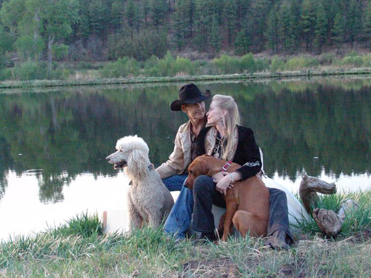 2009. At our ranch in New Mexico with two of our dogs, Lucas and Kuma