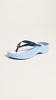 abc1d833f9 YOU ALSO MIGHT LIKE. Tory Burch. Cutout Wedge Flip Flops