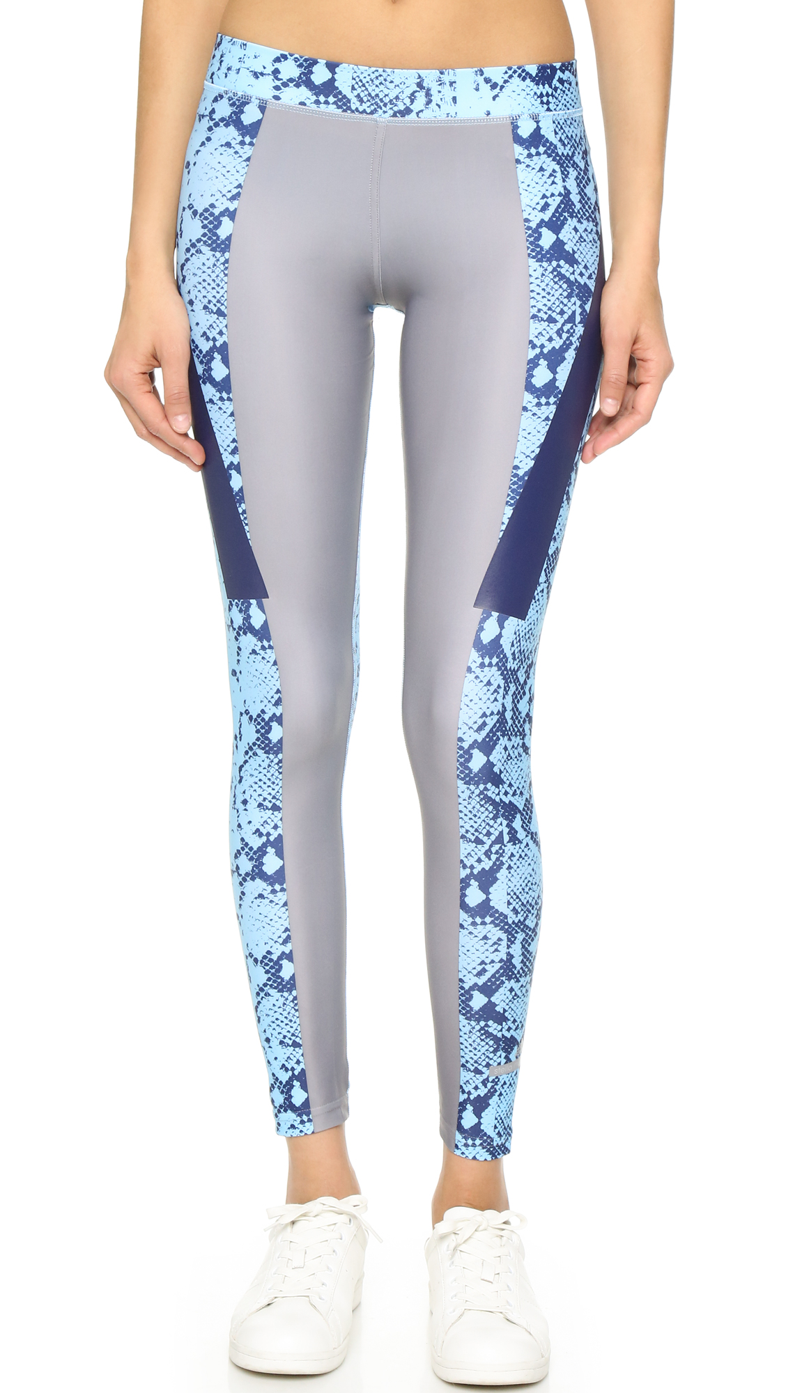 Solid panels and coated stripes bring vivid contrast to these snakeskin print adidas by Stella McCartney leggings. Covered elastic waistband. Fabric: Activewear jersey. 82% polyester/18% spandex. Wash cold. Imported, Philippines. Measurements Rise: 8in / 20.5cm Inseam: 27.5in / 70cm
