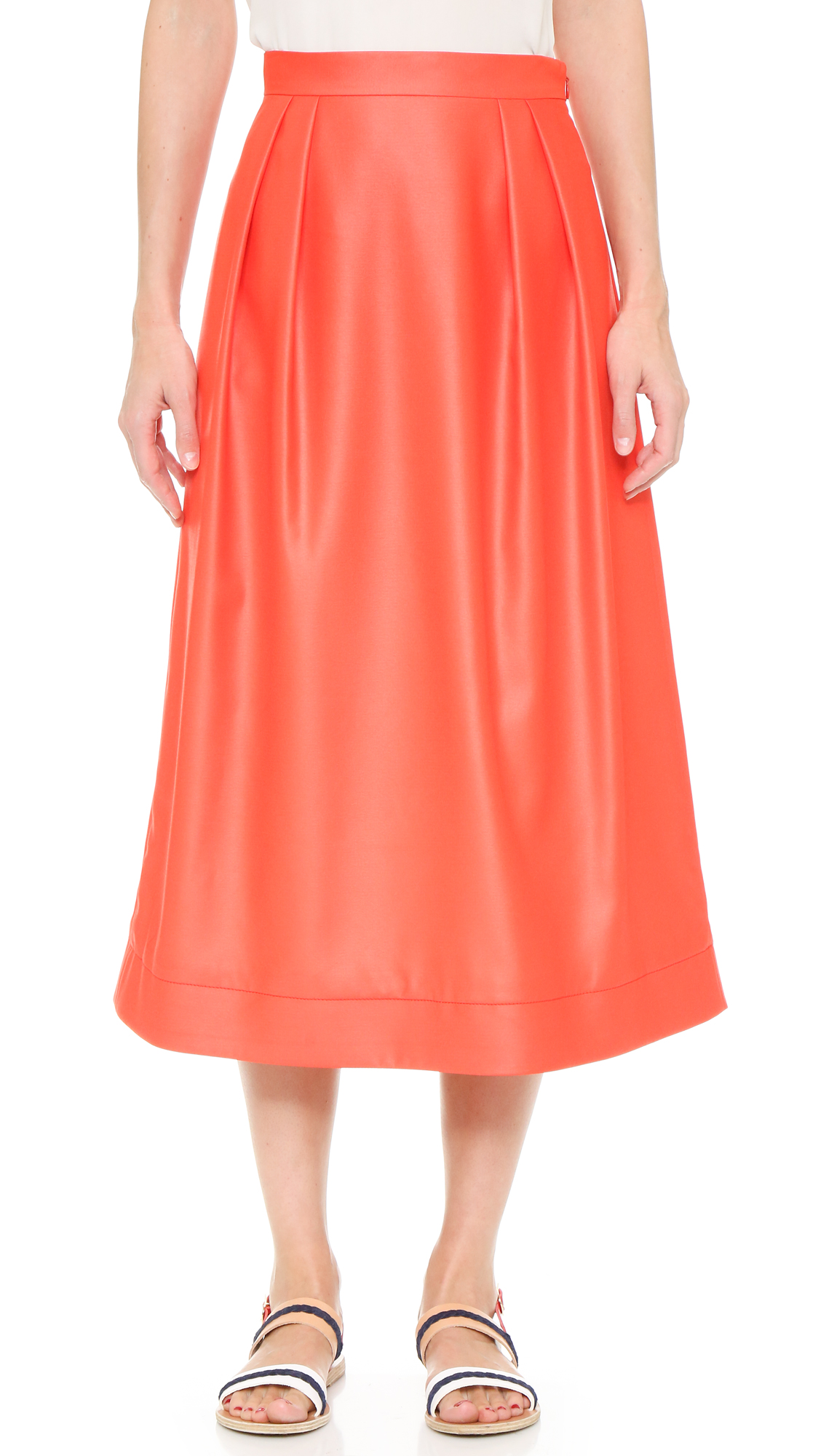 Pleating brings gentle volume to this CG skirt, rendered in a ladylike midi length. Hidden side zip. Silk lining. Fabric: Mid weight weave. Shell: 100% polyester. Lining: 100% silk. Dry clean. Made in the USA. Measurements Length: 32.25in / 82
