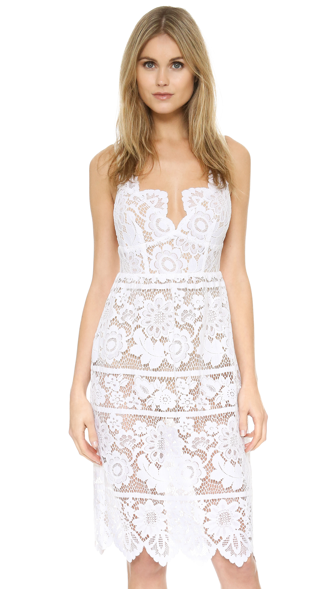 A lingerie inspired For Love & Lemons dress, styled with peek a boo nude bodysuit lining. Adjustable elastic shoulder straps. Semi sheer. Fabric: Lace. Shell: 62.5% cotton/37.5% nylon. Lining: 82% nylon/18% spandex. Dry clean. Imported, China. Measurements Length: 39.25in / 100