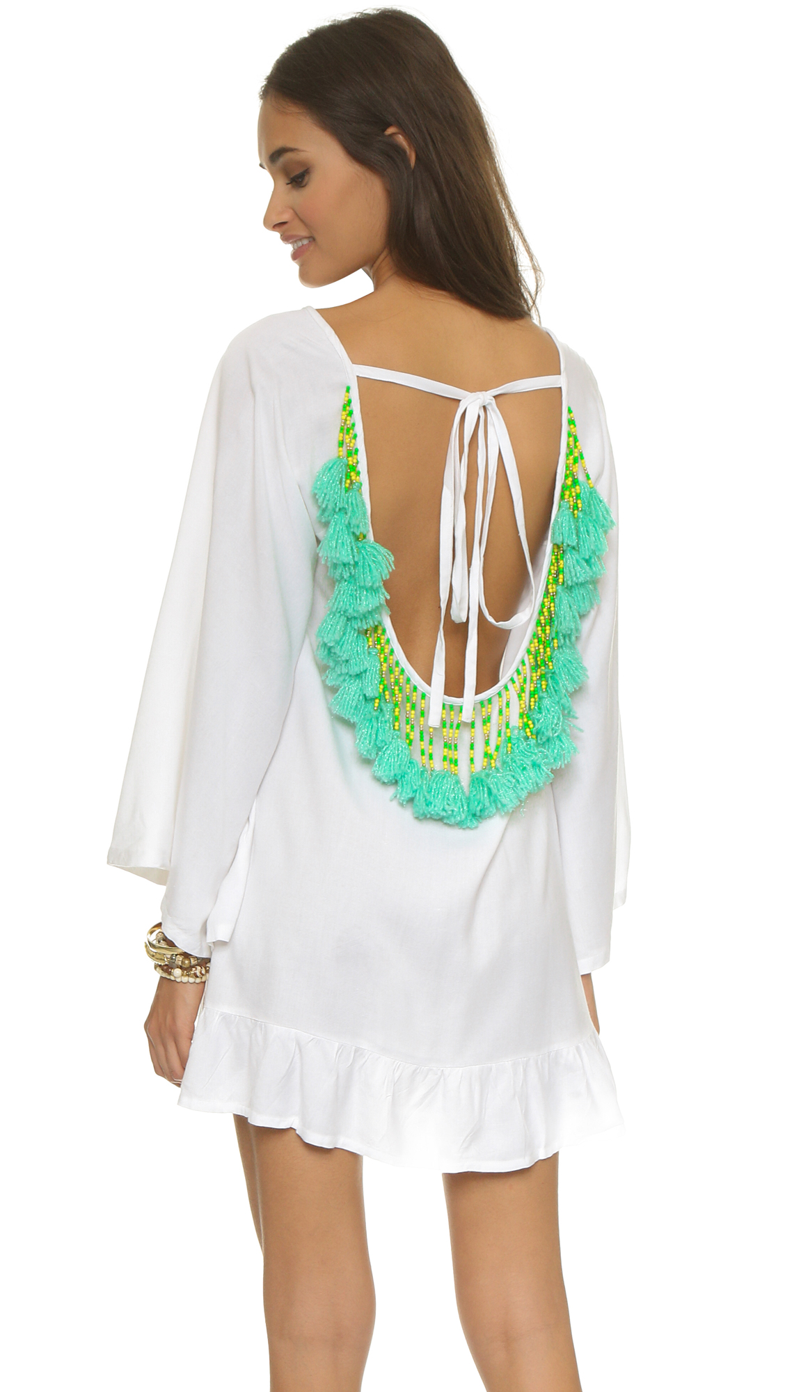 Beads and yarn form bold neon tassels on this SUNDRESS cover-up. Tie closure in back. Kimono sleeves. Fabric: Soft weave. 100% viscose. Hand wash. Imported, India. Measurements Length: 32in / 81cm, from shoulder Measurements from size S