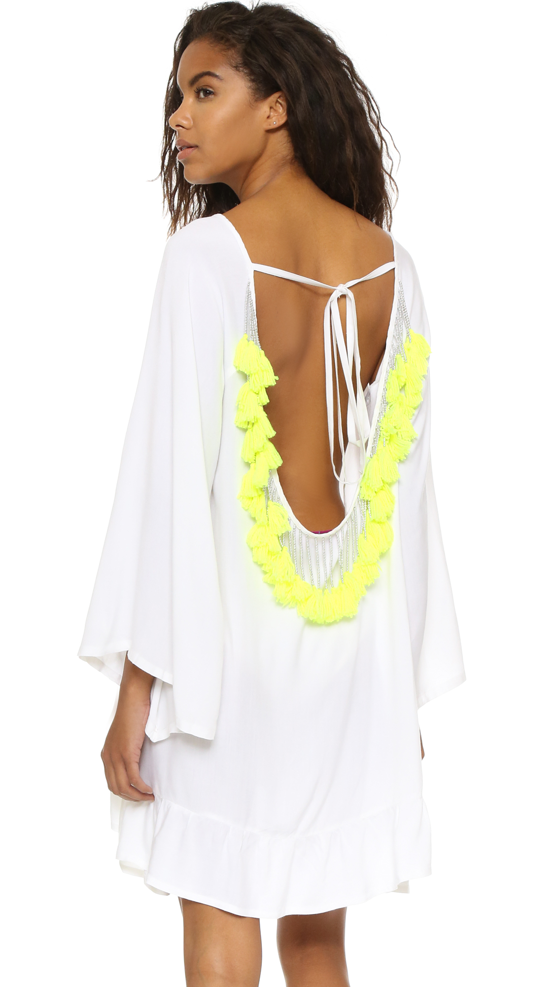 Beads and yarn form tassels on this SUNDRESS cover-up. Tie closure in back. Kimono sleeves. Ruffled hem. Fabric: Soft weave. 100% viscose. Hand wash. Imported, India. Measurements Length: 32in / 81cm, from shoulder Measurements from size S