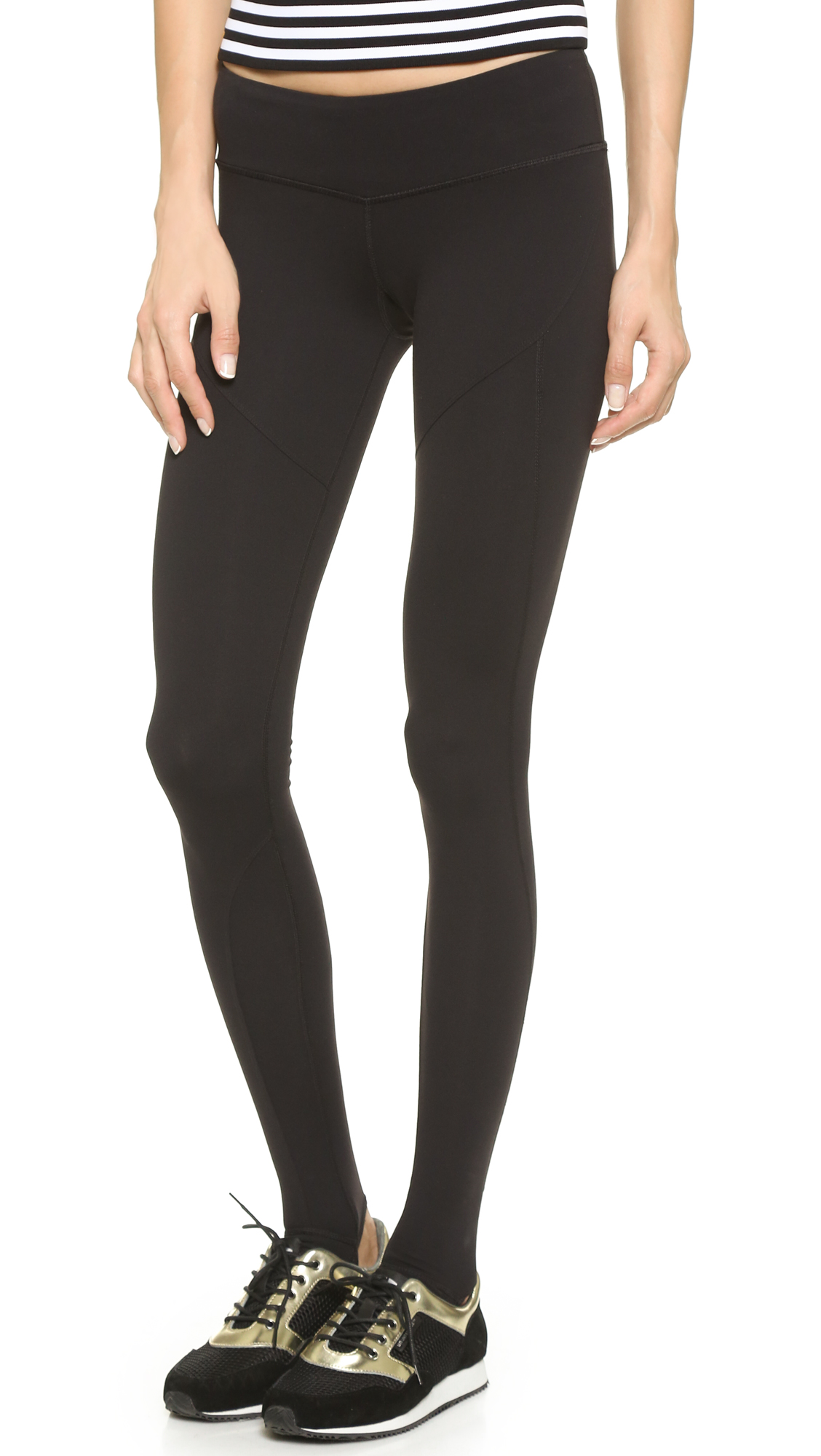 These high rise Splits59 stirrup leggings have curved, overlock seams. Textured grip at cutout heel. Fabric: Activewear jersey. 88% nylon/12% spandex. Wash cold. Imported, China. Measurements Rise: 6.75in / 17cm Inseam: 27.25in / 69cm Measurements from size S. Available