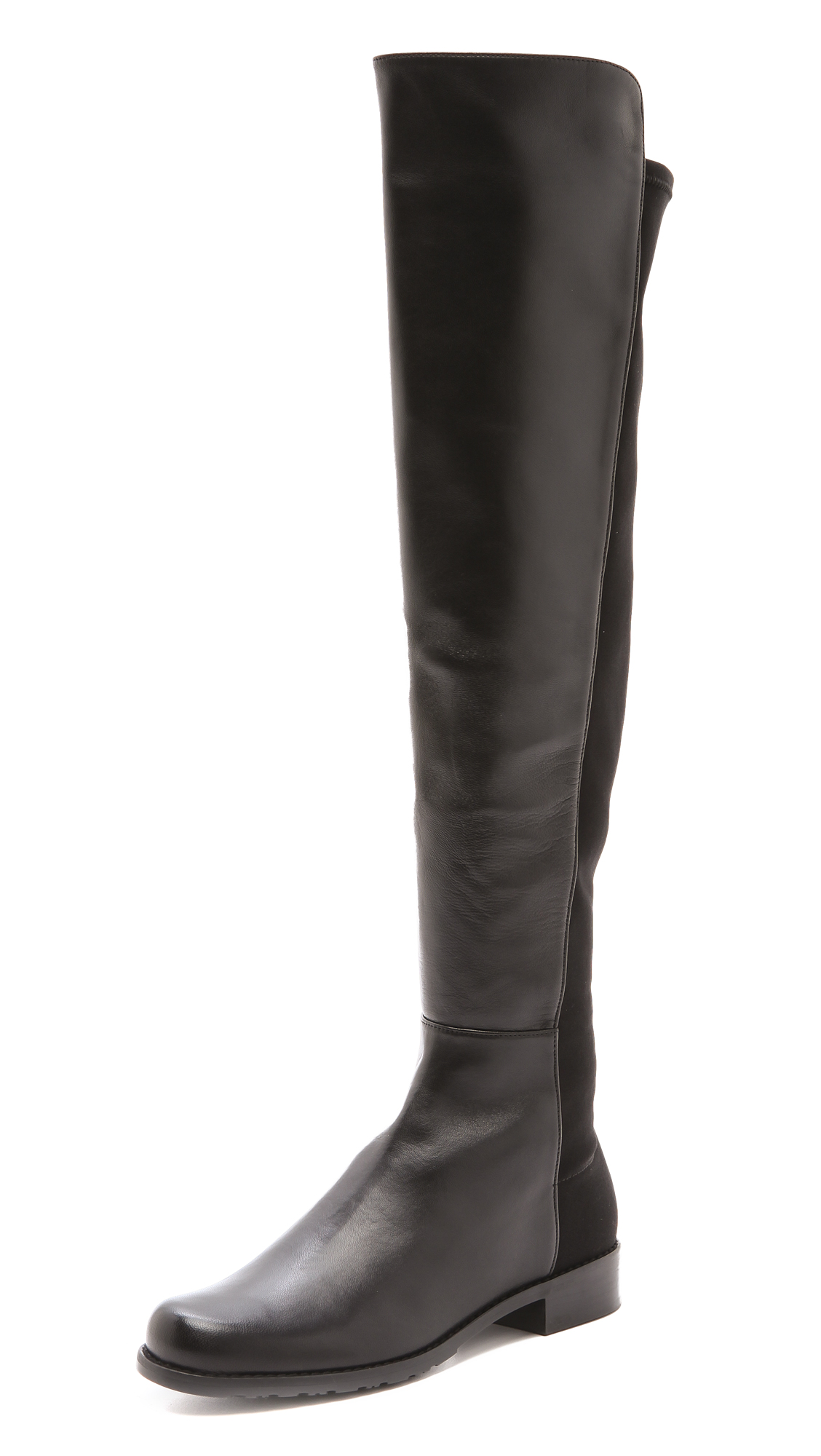 A tonal panel of soft elastic contours the silhouette of these over the knee Stuart Weitzman boots. Rubber sole. Leather: Goatskin. Imported, China. This item cannot be gift boxed. Measurements Heel: 1in / 25.5mm Shaft: 21in / 53.5cm