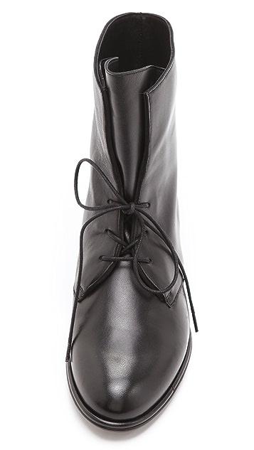 Stuart Weitzman Stepmistress Hidden Wedge Booties