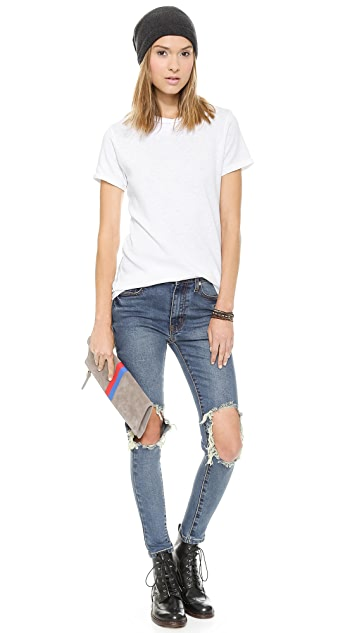 UNIF Peach Pit Skinny Jeans
