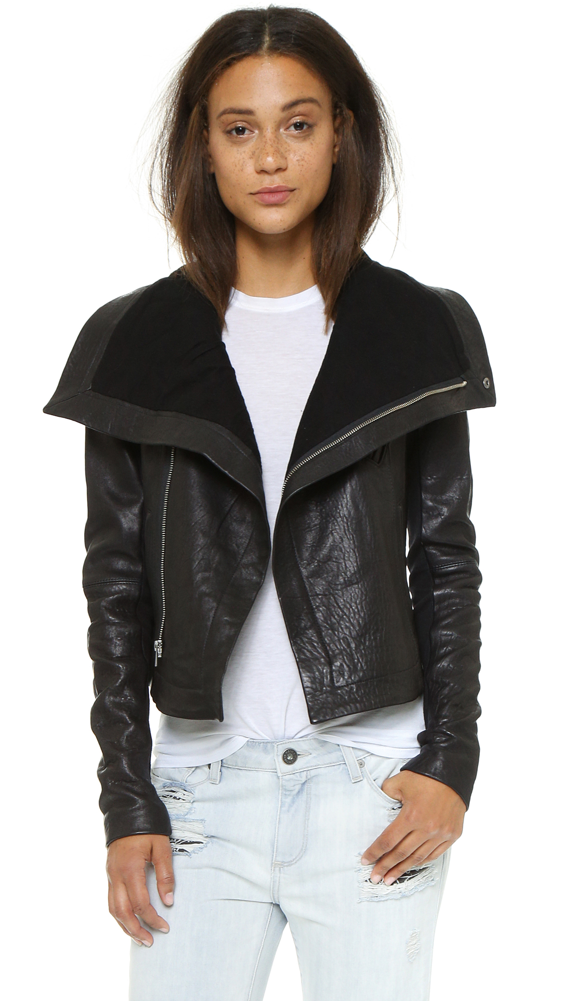A funnel collar adds cool volume to this lambskin leather jacket, designed with 3 pockets and an off center zip. Ribbed insets give the long sleeves a snug fit. Lined. Fabric: Lambskin. Shell: 100% lambskin. Trim: 95% cotton/5% spandex.