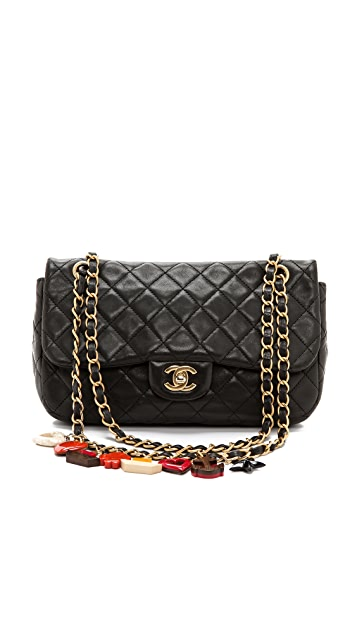 What Goes Around Comes Around Vintage Chanel Black Quilted Charm Bag