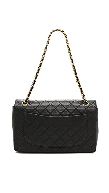What Goes Around Comes Around Vintage Chanel Black Quilted Half Flap Bag