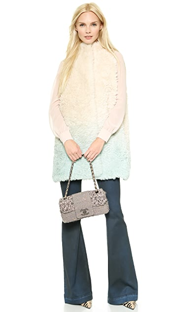 What Goes Around Comes Around Chanel Boucle Half Flap Bag