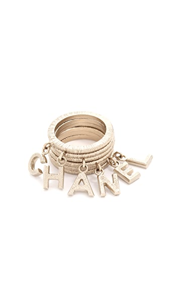 What Goes Around Comes Around Chanel Dangling Letters Ring Set (Previously Owned)