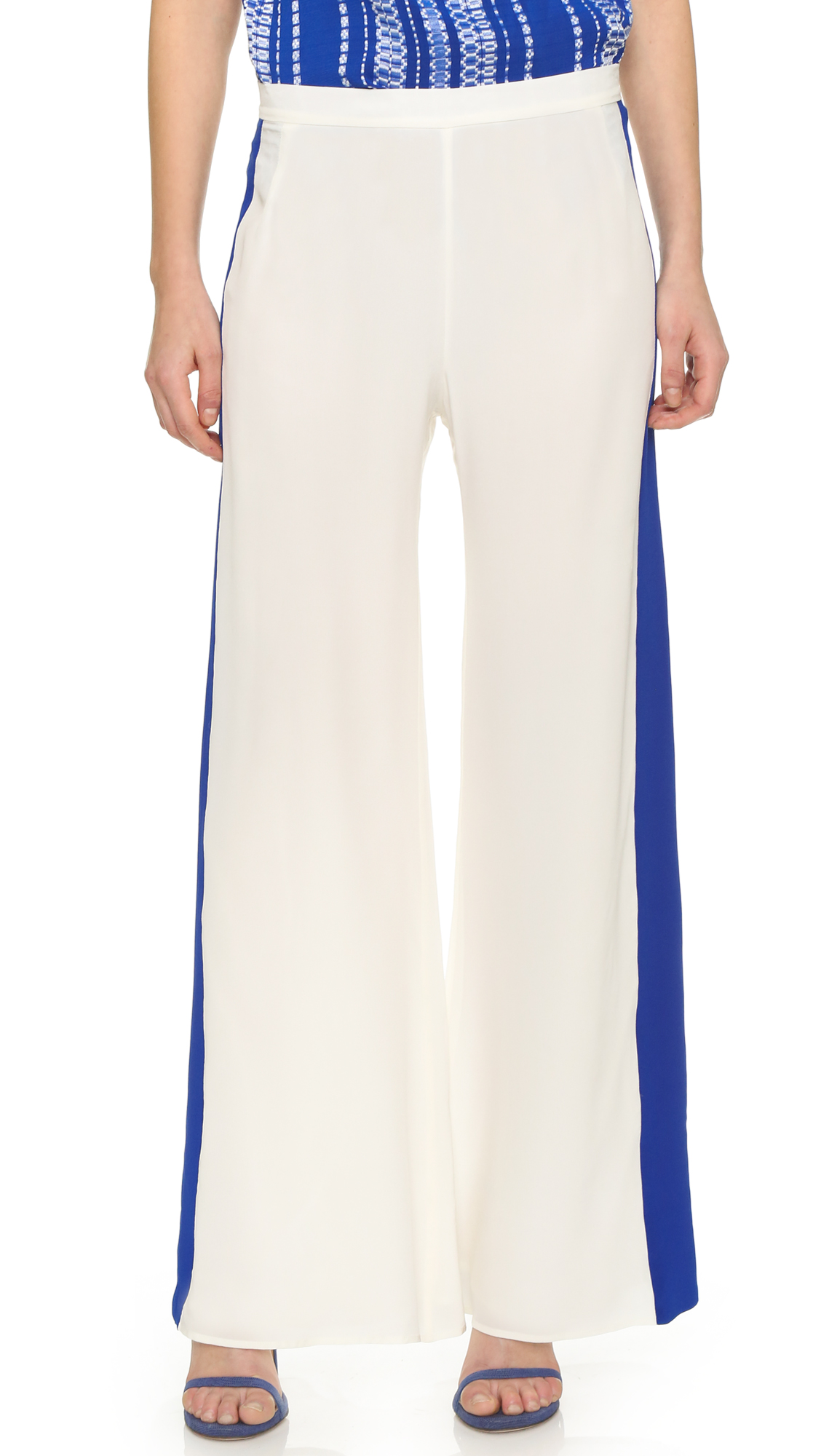 Wide leg ZEUS+DIONE trousers rendered in smooth silk. Bright stripes trim the sides. Hidden back zip. Lined. Fabric: Plain weave silk. Shell: 100% silk. Lining: 100% cupro. Dry clean. Made in Greece. Measurements Rise: 11in / 28cm Inseam: 30