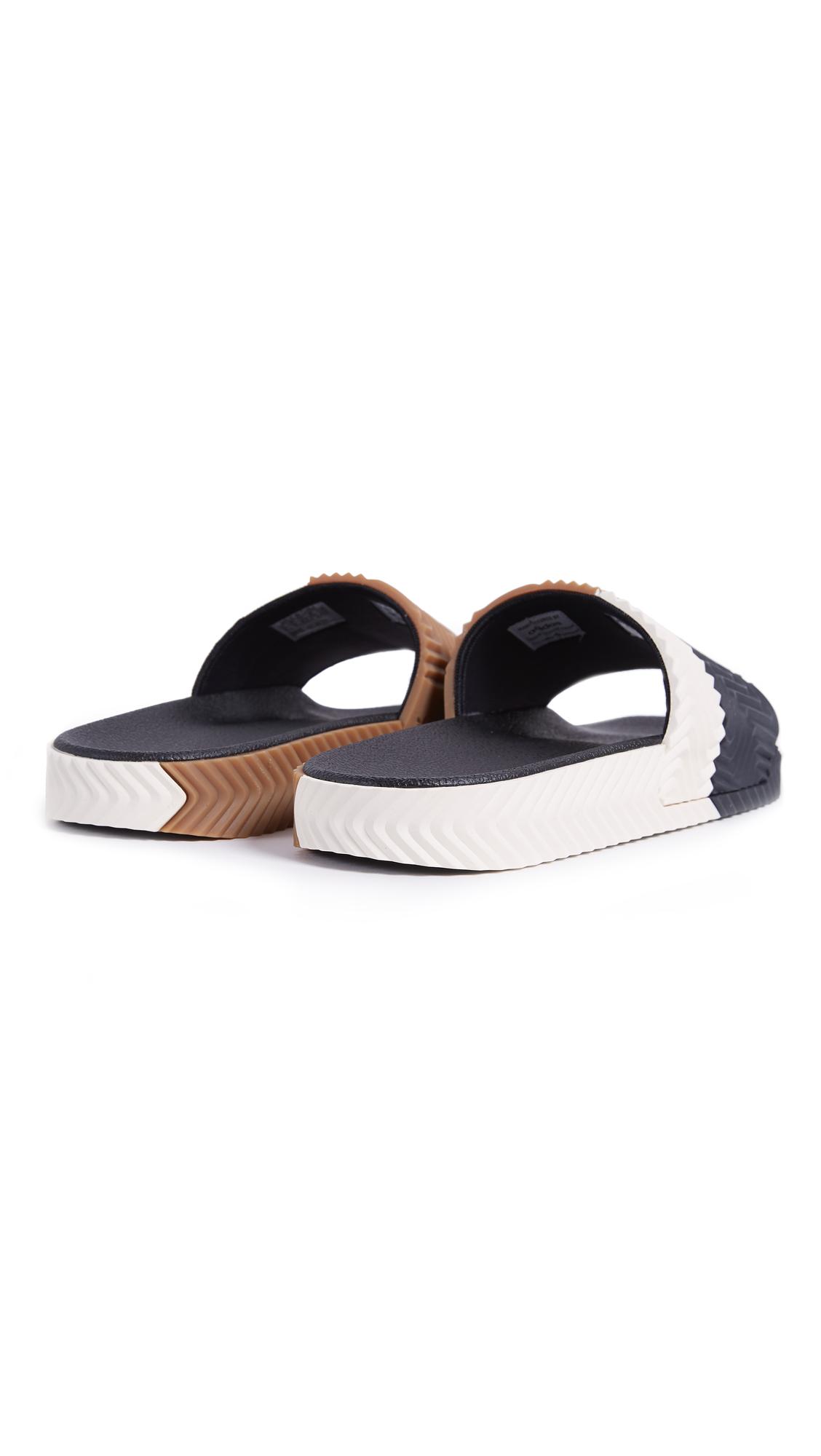 7c9bdf2264bc5 adidas Originals by Alexander Wang AW Adilette Sandals