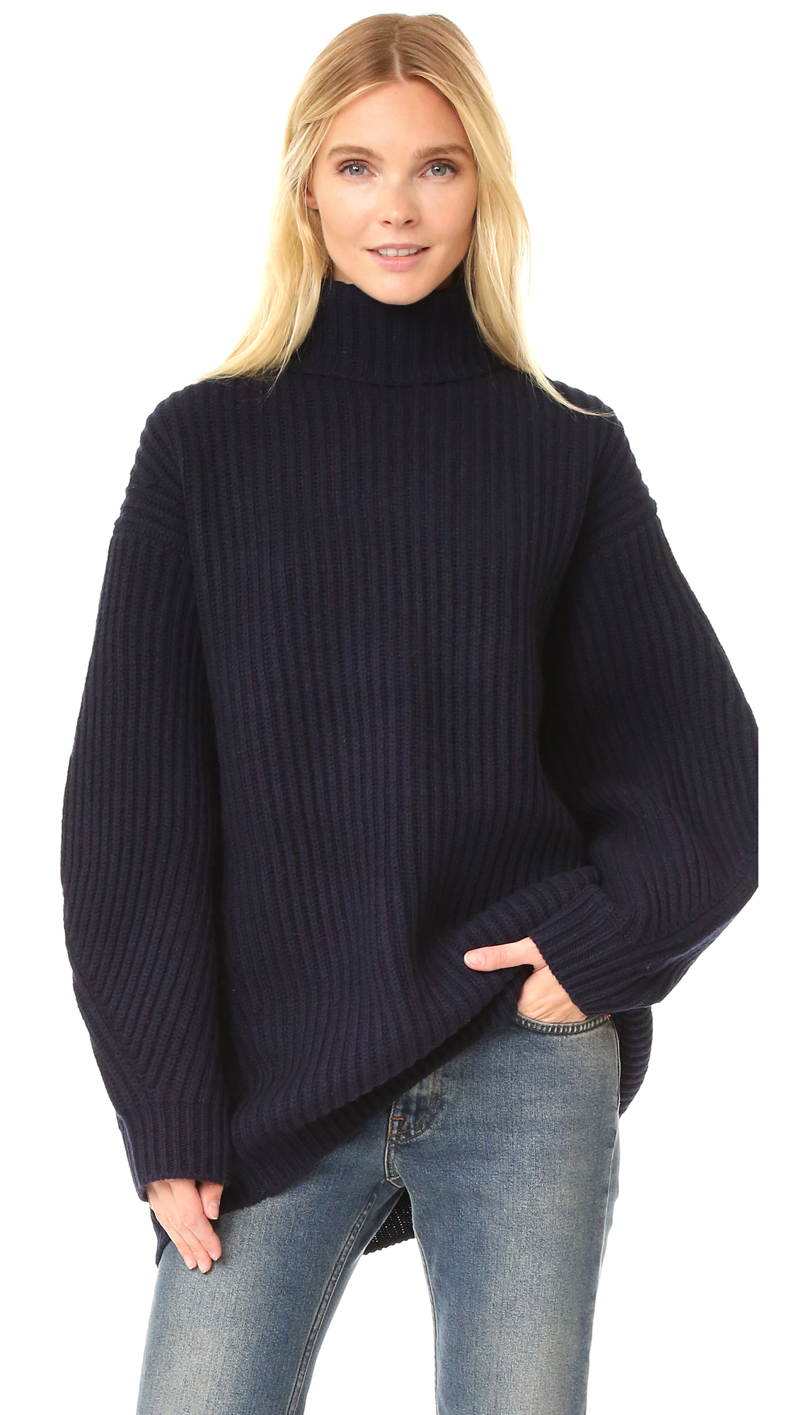 A ribbed, oversized Acne Studios sweater with a cozy mockneck profile. Boxy, tapered long sleeves. Uneven hem. Fabric: Thick, ribbed knit. 100% wool. Hand wash. Imported, China. Measurements Length: 30in / 76cm, from shoulder Measurements from size S.
