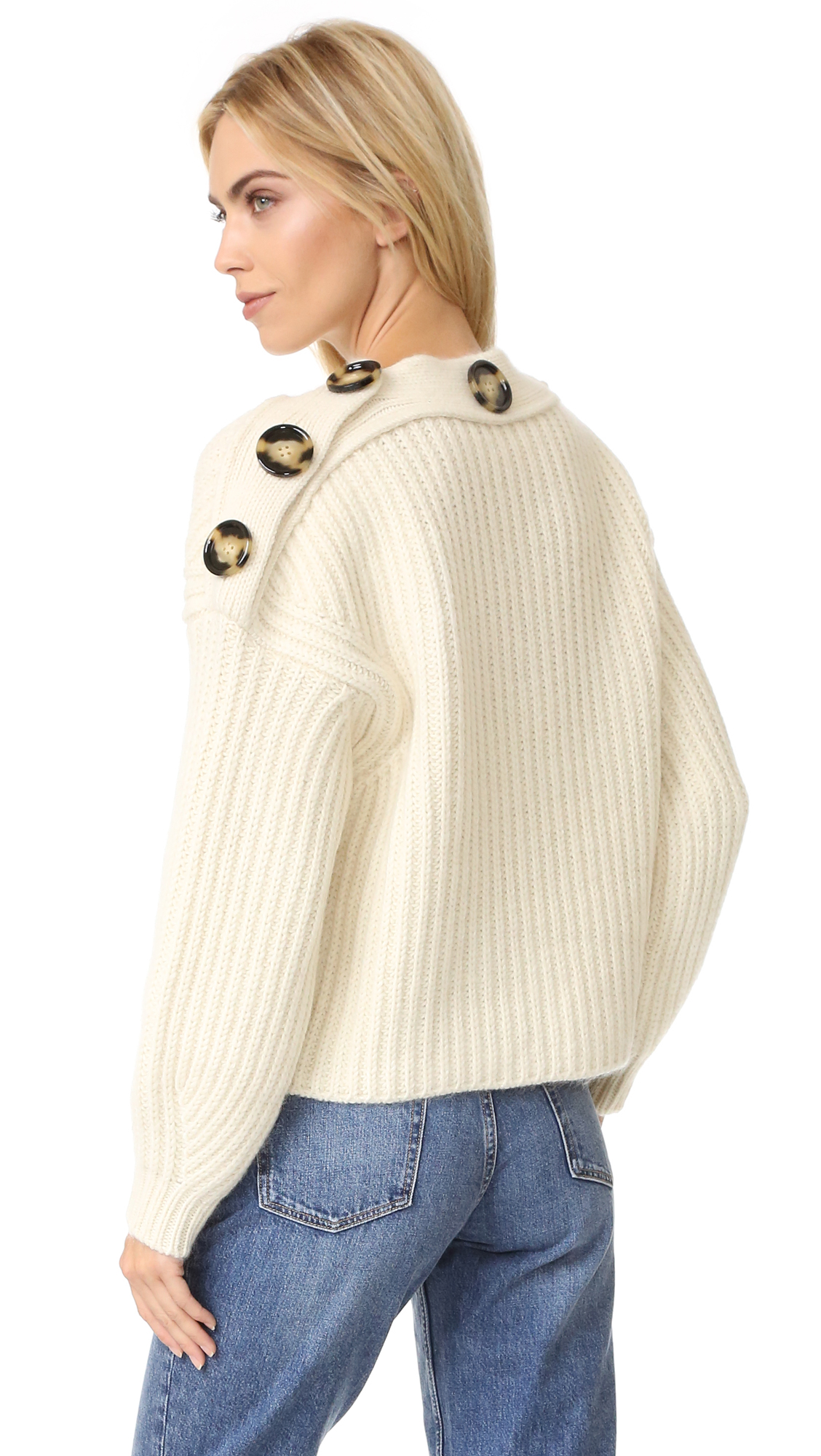 Oversized buttons add unique asymmetry to this boxy Acne Studios sweater. 3/4 sleeves with ribbed cuffs. Fabric: Brushed, chunky knit. 85% wool/10% mohair/5% nylon. Hand wash or dry clean. Made in Italy. Measurements Length: 22.75in / 58cm, from shoulder