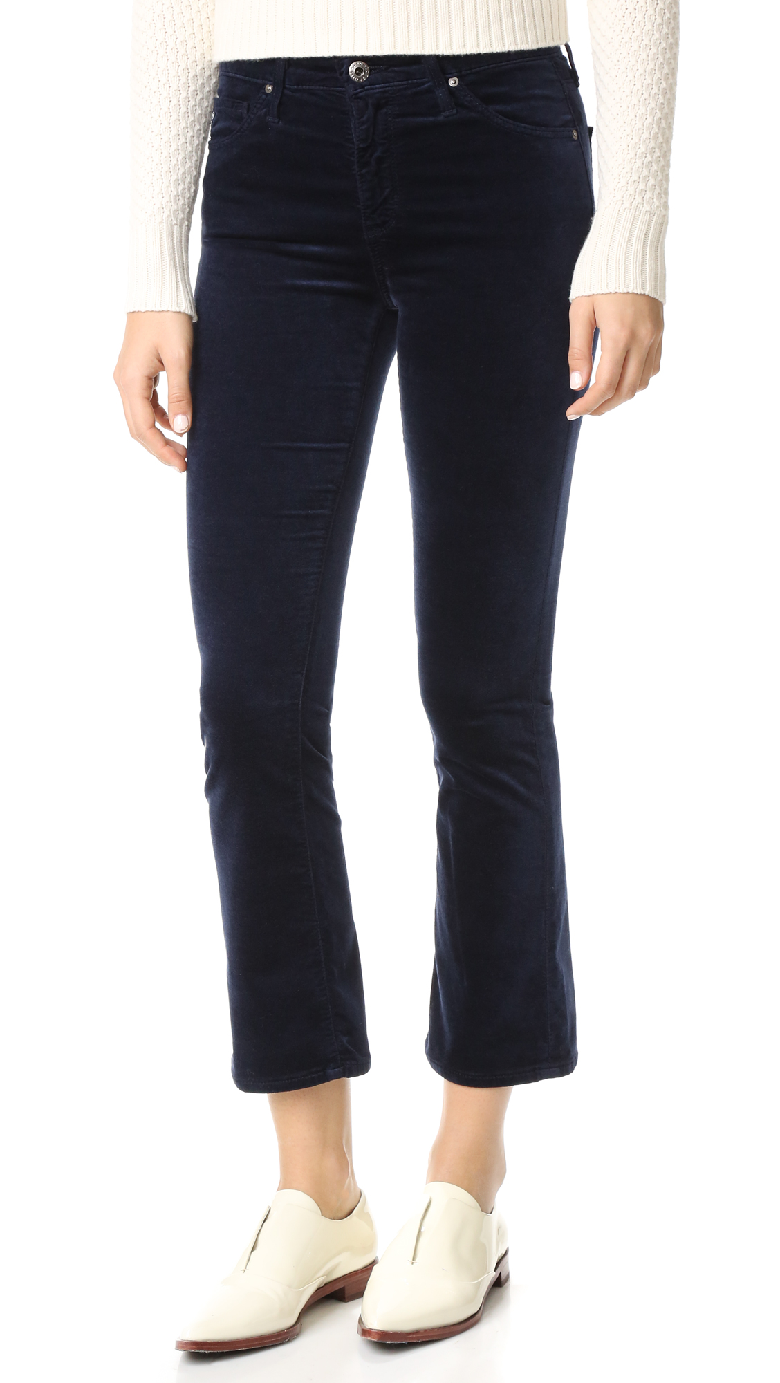 A cropped profile lends a shrunken effect to these luxe velveteen AG pants. 5 pocket styling. Button closure and zip fly. Fabric: Velveteen. 54% cotton/35% modal/8% polyester/3% polyurethane. Wash cold. Made in the USA. Imported materials. Measurements Rise: 9
