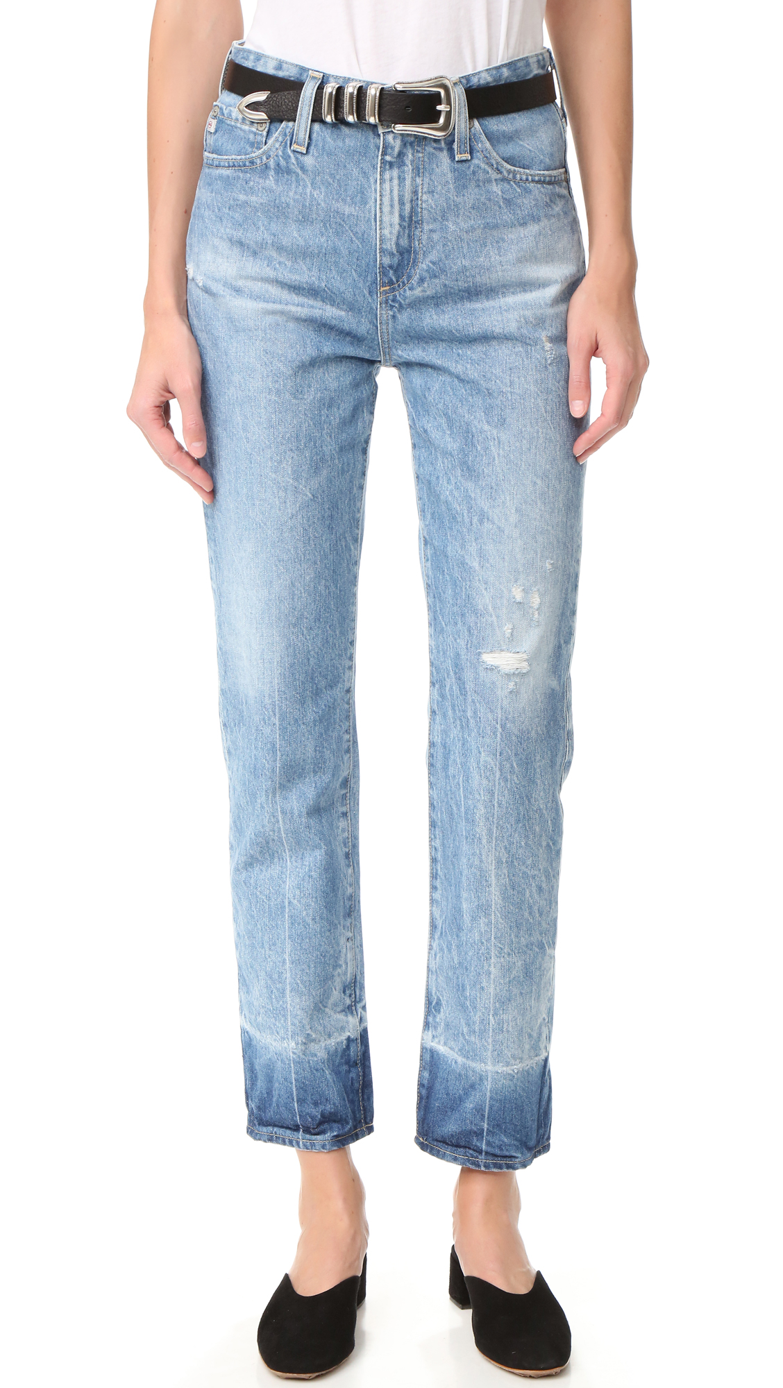 These high waisted AG straight leg jeans are finished in a crinkled, acid like wash with overdyed cuffs. 5 pocket styling. Button closure and zip fly. Fabric: Denim. 100% cotton. Wash cold. Made in the USA. Measurements Rise: 11