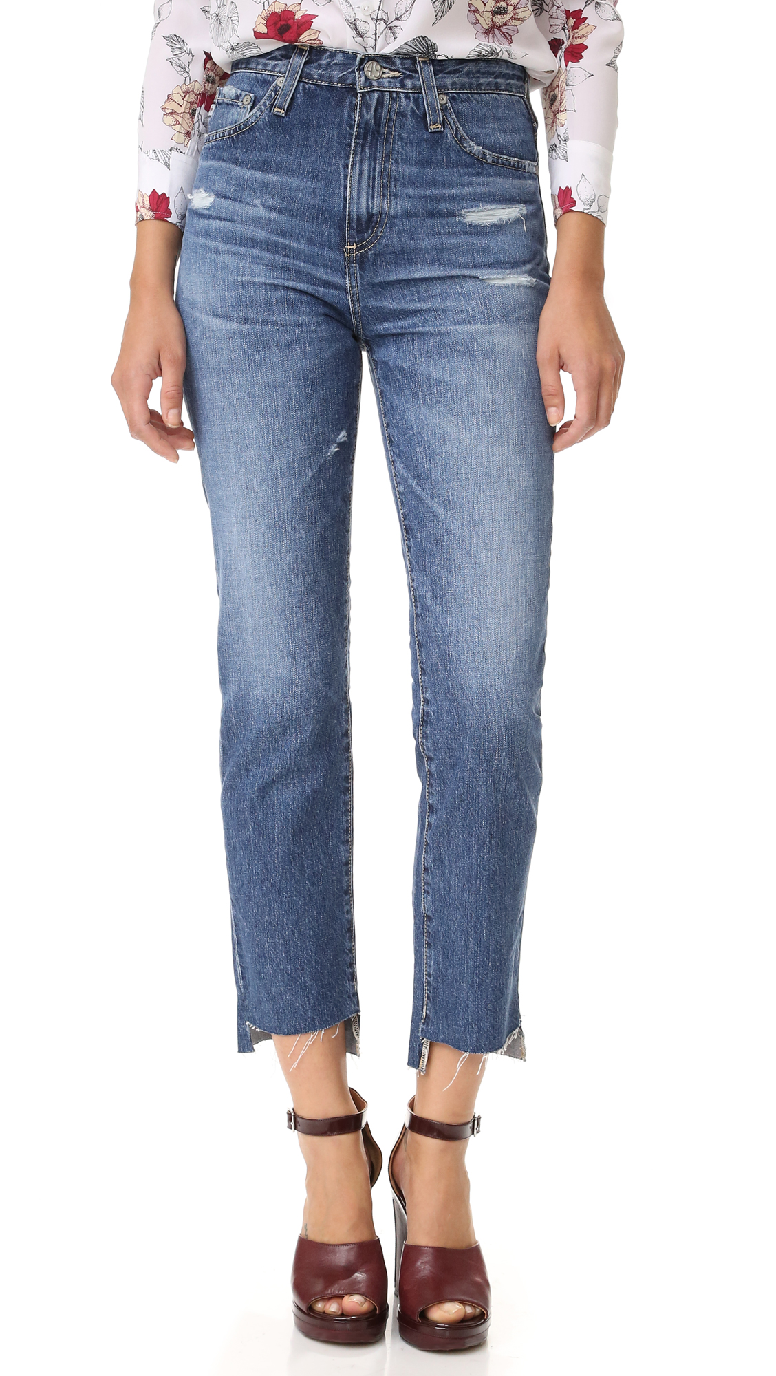 Shredded holes and whiskering complement the favorite pair feel of these high waisted AG jeans. Raw, notched cuffs. 5 pocket styling. Button closure and zip fly. Fabric: Denim. 100% cotton. Wash cold. Imported, Mexico. Measurements Rise: 10.75in / 27.5cm