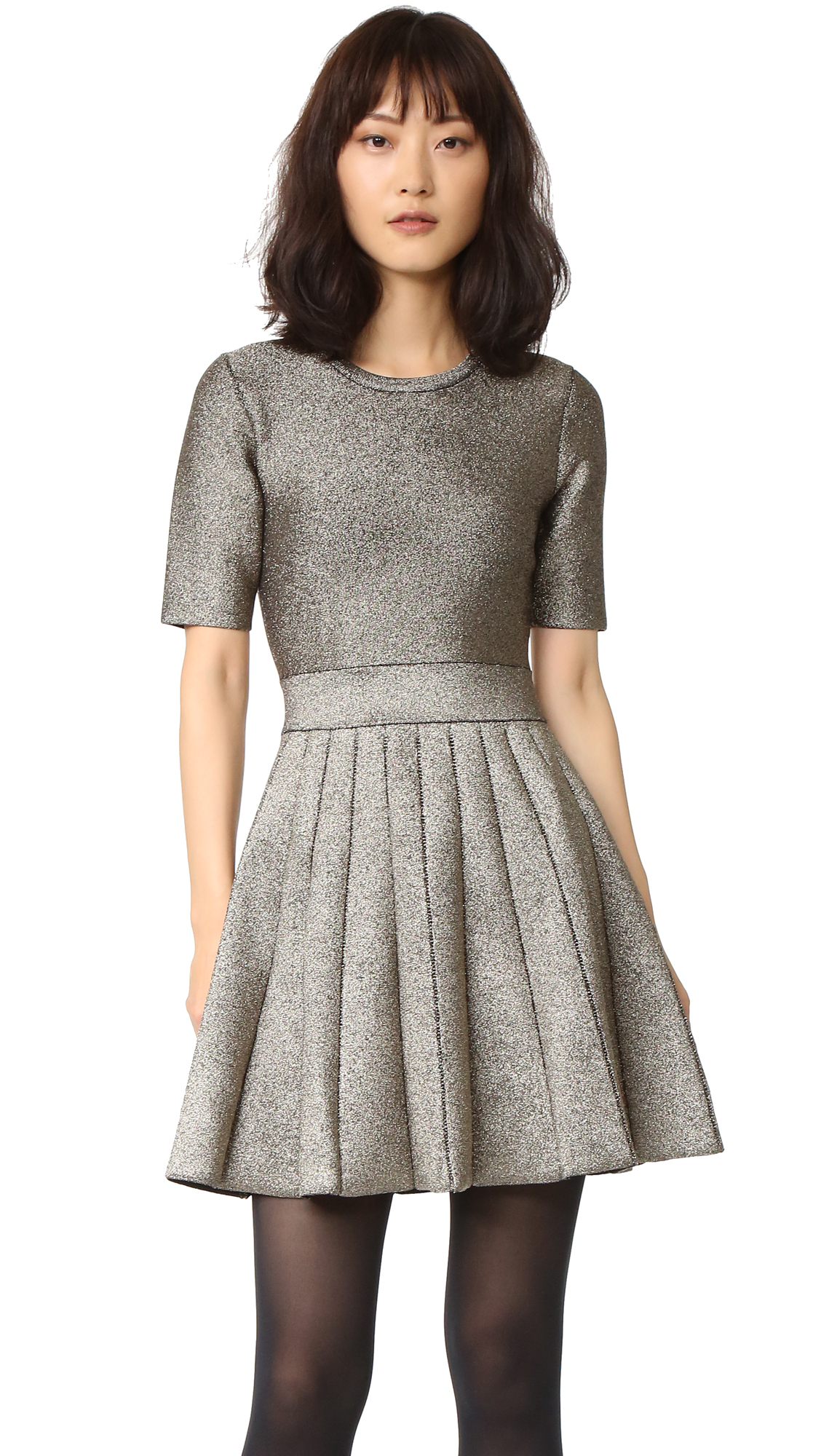 An A.L.C. fit and flare dress with a metallic sheen, detailed with lattice trim at the skirt. Half sleeves. Unlined. Fabric: Double knit. 54% rayon/33% nylon/11% metallic/2% elastane. Dry clean. Imported, China. Measurements Length: 33.75in / 86