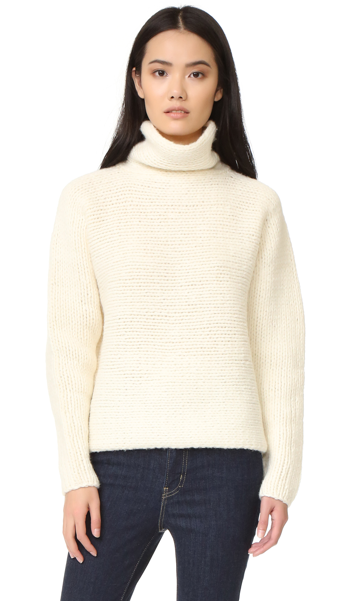 Chunky stitches lend soft texture to this cozy A.L.C. turtleneck sweater. Long dolman sleeves. Fabric: Chunky knit. 100% wool. Dry clean. Imported, China. Yarn from Italy. Measurements Length: 22.75in / 58cm, from shoulder Measurements from size