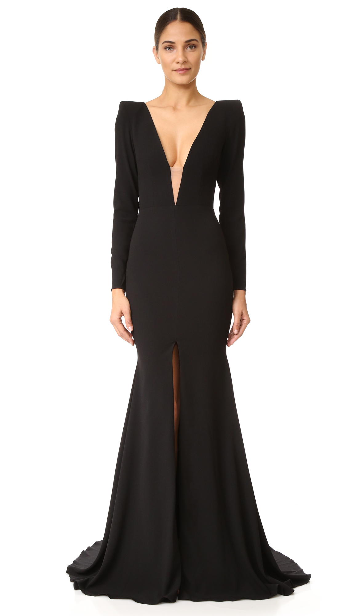 Description NOTE: Sizes listed are Australian. Please see Size & Fit tab. A striking Alex Perry gown with a daring neckline and revealing open back. Sheer mesh trims the deep V, and the floor length skirt is