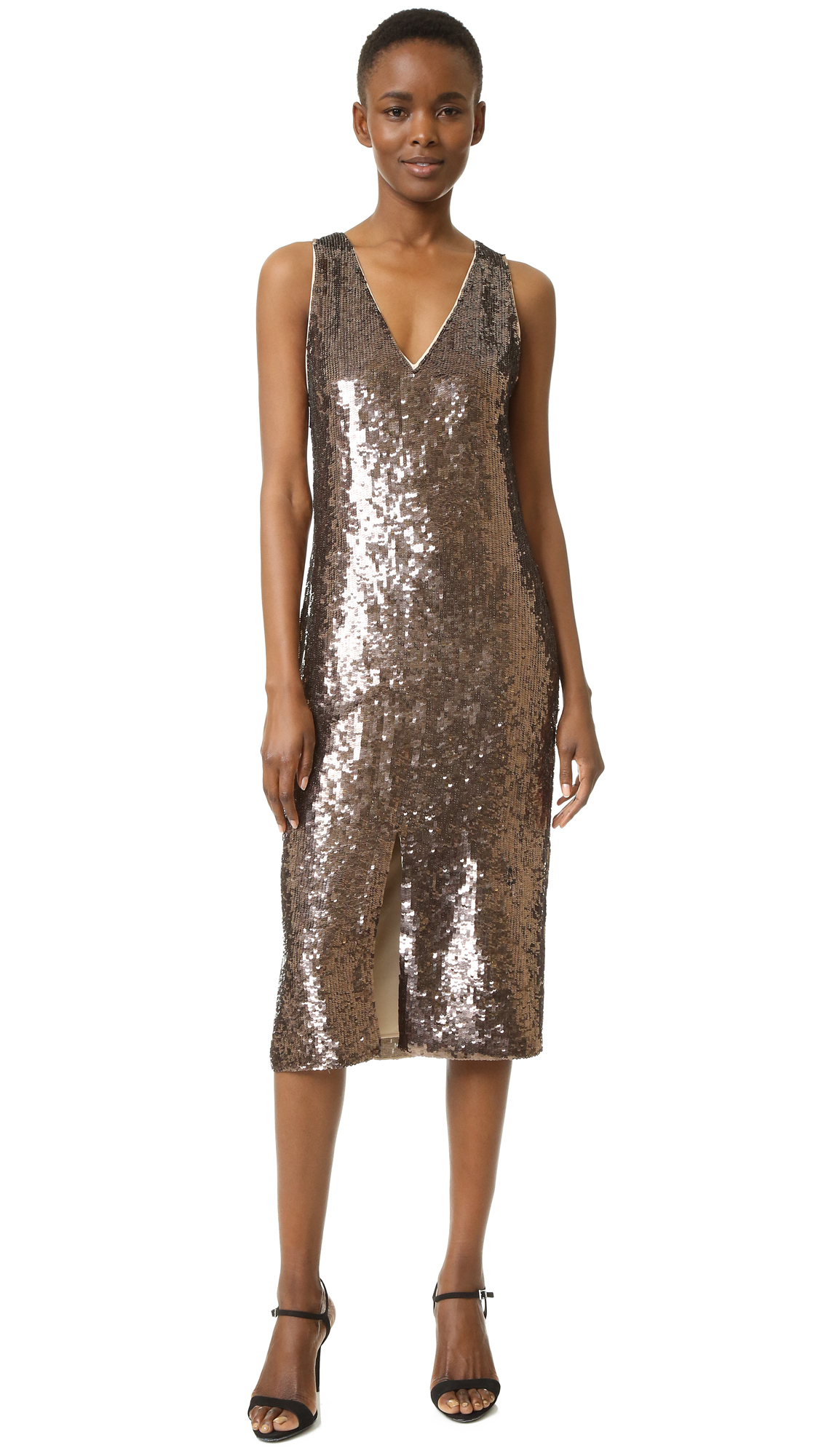 Sequins cover this opulent alice + olivia dress. A front vent relaxes the fit. Deep V neckline. Sleeveless. Exposed back zip. Lined. Fabric: Sequined gauze. Shell: 100% polyester. Lining: 95% polyester/5% elastane. Dry clean. Imported, India. Measurements Length: 43.25in / 110