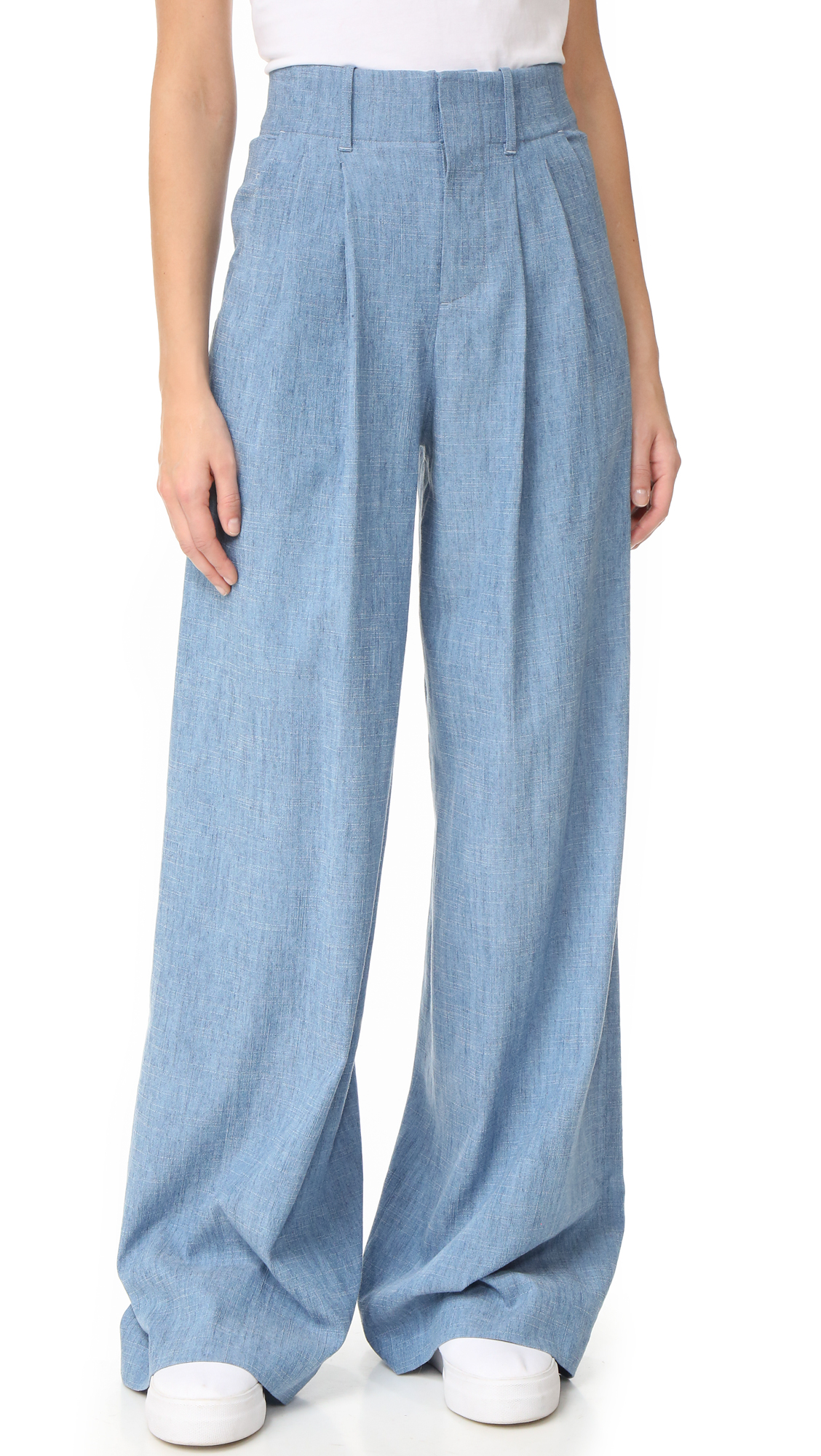 Long rise alice + olivia pants in a dramatic wide leg profile. Slant front pockets and welt back pockets. Hook and eye closure and zip fly. Fabric: Chambray. 62% lyocell/19% linen/19% polyester. Dry clean. Imported, China. Measurements Rise: 14