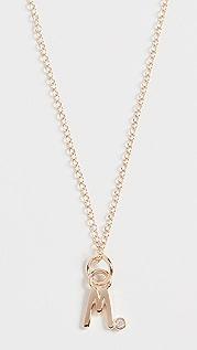 Alison Lou Колье из 14-каратного золота с буквой, украшенной бриллиантами в закрепке «безель»