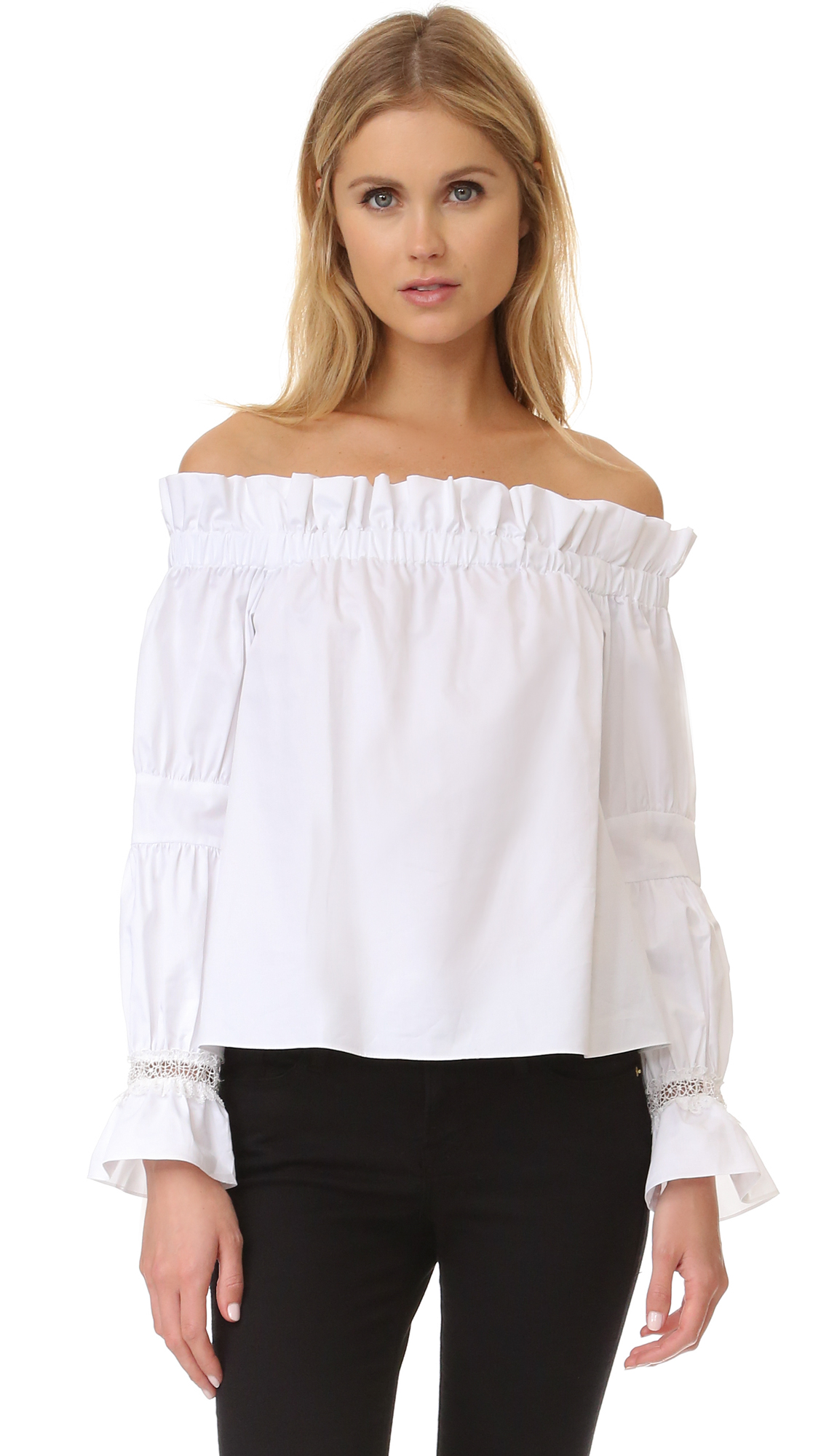 An off shoulder Alexis top with ruffled edges and crochet trim. Long blouson sleeves. Fabric: Sateen. 100% cotton. Dry clean. Imported, China. Measurements Length: 17.75in / 45cm, from center back Measurements from size S. Available sizes: M