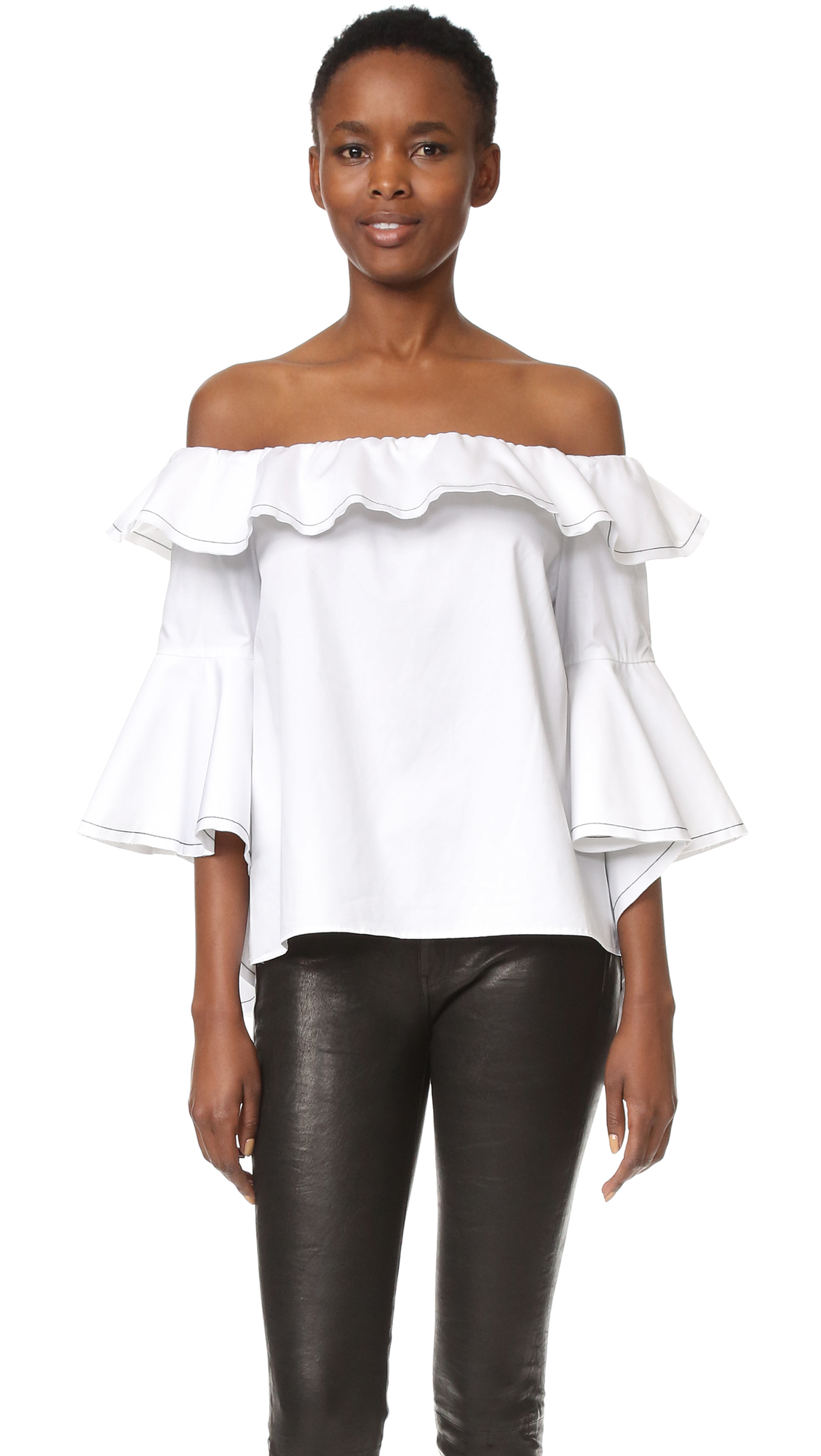 Angel sleeves give this Alexis crop top a dramatic, voluminous profile. A ruffle trims the off shoulder neckline, and contrast topstitching traces the raw edges. Fabric: Lightweight weave. 100% cotton. Dry clean. Imported, China. Measurements Length: 17in / 43