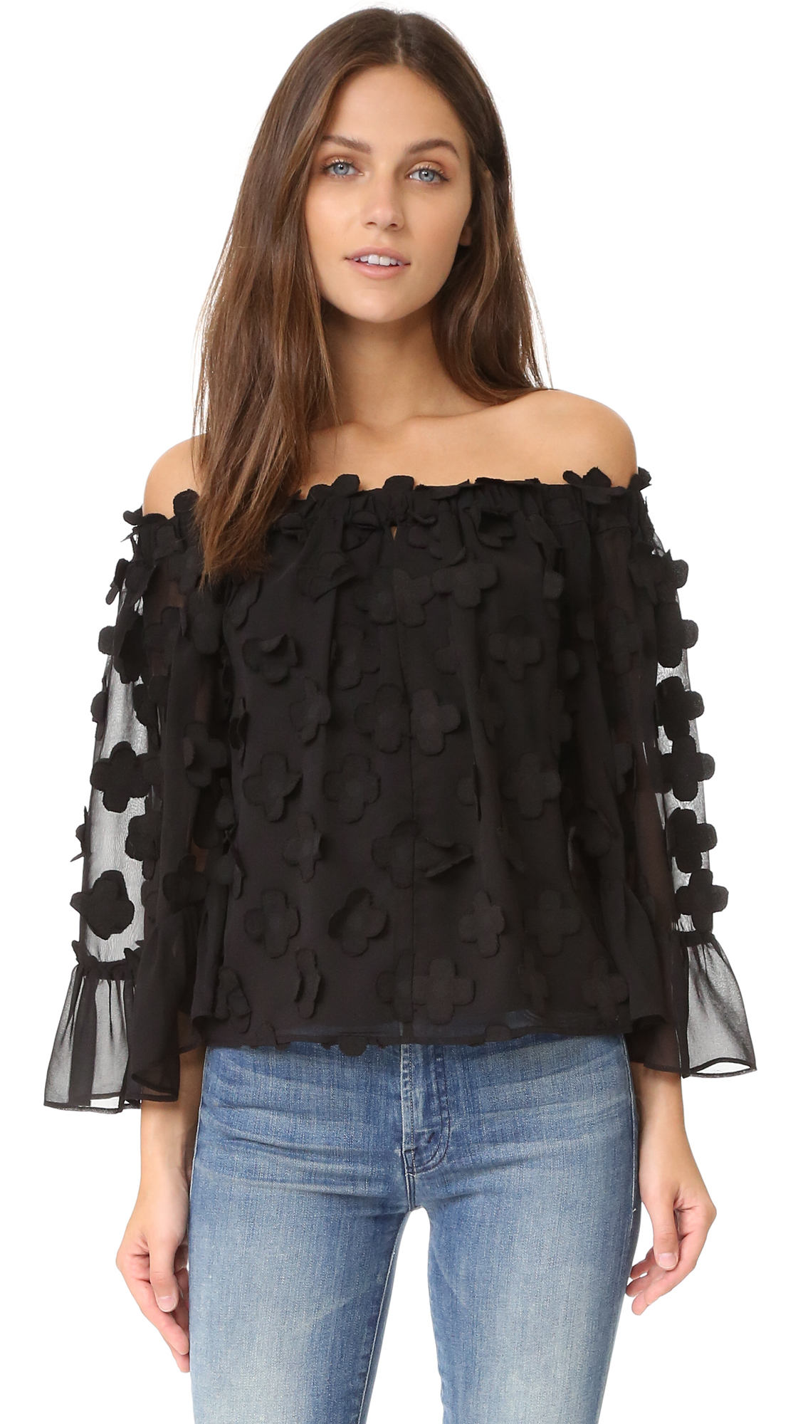 Description NOTE: Sizes listed are Australian. Please see Size & Fit tab. Appliqué flowers bring soft, feminine texture to this off shoulder Alice McCall top. Covered elastic top hem. Bell sleeves. Lined. Fabric: Chiffon. 100% polyester. Hand wash.
